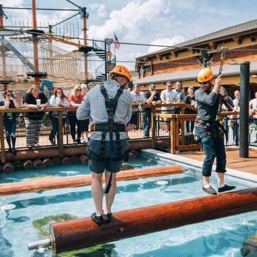 log roll contest in harnesses at lumberjack adventure park