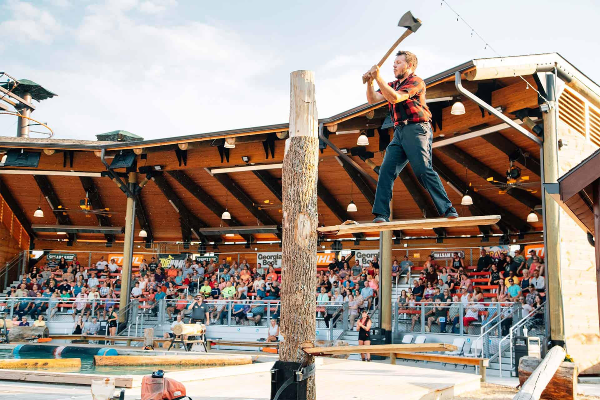 spring board chop during lumberjack show in pigeon forge