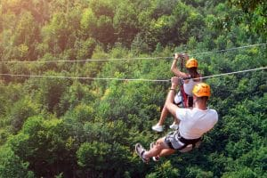 people ziplining in the smoky mountains