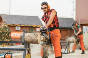 lumberjack sawing wood